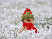 Smiling snowman in the snow — Stock Photo