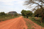 Dusty Road leading to Abela Rock, Uganda, Africa — Stock Photo