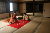 Japanese Models Playing Ancient Game — Stock Photo