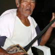 Old Man Playing Sanshin Guitar, Okinawa, Japan - Stock Photo