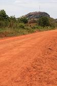 Dusty Road leading to Abela Rock, Uganda, Africa — Stock Photo