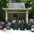 Worship in Temple -Taketomi Island , Okinawa, Japan - Stock Photo