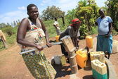 Pumping Water - Uganda, Africa — Stock Photo