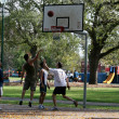 Foto de Stock  : Playing Basketball - Carlton Gardens, Melbourne, Australia