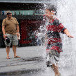 Playing in the Water Fountain - Toronto, Canada - Stock Photo