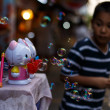 Stock Photo: Boy playing with bubbles at market Chatuchak