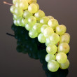 Green grape isolated over black glass background — Stock Photo