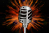 Retro microphone over explosive background — Stock Photo