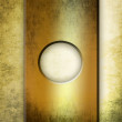Metallic plate over grunge wall — Stockfoto
