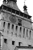 Black and white scene of clock tower from Sighisoara citadel — Stock Photo