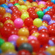 Plastic balls in different colors for kids — Photo