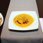 Pumpkin soup on restaurant table — Stock Photo