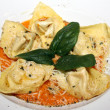 Tortelloni pasta with sauce and parmesan — Stockfoto