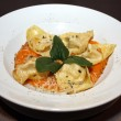 Tortelloni with sauce and parmesan on white plate — Photo