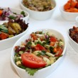 Closeup scene of different types of salads on restaurant table — Stock Photo