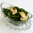 Ruccola salad with mushrooms on glass bowl — Stock Photo