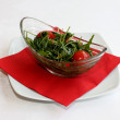 Closeup scene with ruccola salad and cherry tomatoes — Stock Photo