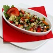 Stock Photo: Mixed salad on restaurant table