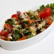 Mixed salad on white plate — Stock Photo