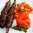 Stock Photo: Grilled meat with carrots saute and tomato
