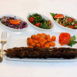 Stock Photo: Grilled meat with carrots saute and salad on white plate