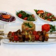 Stock Photo: Grilled meat and vegetables with different types of salad