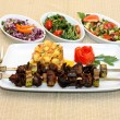 Grilled meat with potatoes and salad — Stock Photo