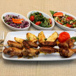 Grilled chicken legs with potatoes and salad — Stock Photo