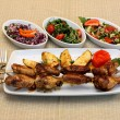 Stock Photo: Grilled chicken legs with potatoes and salad