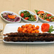 Grilled meat with carrots saute and salad on white plate — 图库照片