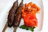 Grilled meat with carrots saute and tomato — Stock Photo
