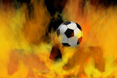 Soccer ball through flames — Stock Photo