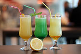 Three fresh tropical juices with lemon — Stock Photo