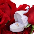 Gold ring in a box of swan on roses — Stock Photo
