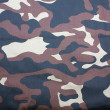 Camouflage fabric background — Stock Photo #42052843
