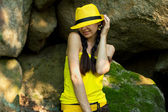 Smiling girl with two pigtails in a yellow hat  — Stock Photo
