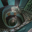 Grunge, green spiral staircase — Stock Photo