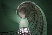 Spiral old green and grunge staircase — Stock Photo