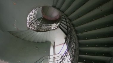 Spiral old and grunge staircase in green color, abstract point of view — Stock Video