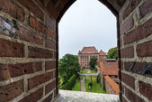 View through window to old castle in Malbork — Stock Photo