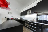 Modern black and white kitchen interior — Stok fotoğraf