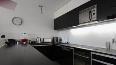 Moder black and white kitchen interior with red lamp — Stock Video