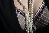 Black, stylised bra with pearls — Stock Photo