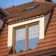 Wooden window on the roof — Stock Photo