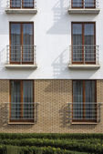 Wooden windows in multi family house — Stock Photo