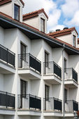 Balconies in multi family house exterior — Stock Photo