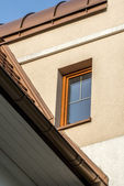 Single wooden window in multi family house — Stock Photo