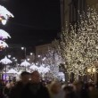 Crowded street decorated for Christmas in Warsaw a capital of Poland. — Stock Video