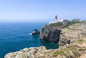 Rocky coastline and lighthouse in Sagres, Portugal — Stock Photo