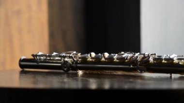 Flute fragment n a wooden table — Stock Video